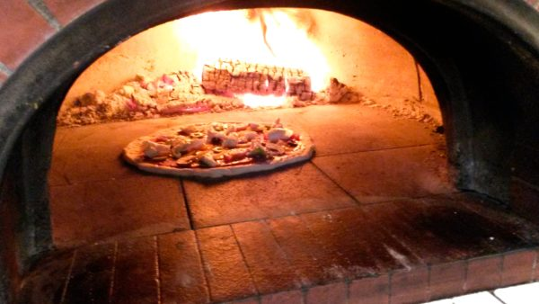 Old fire station cafe, pizzeria, wood-fired pizza, cooking pizza
