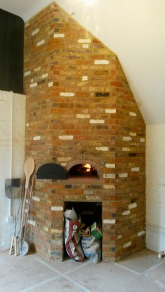 Oven in reclaimed brick enclosure
