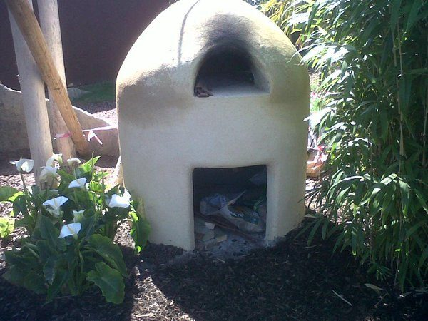 Finished clay cob oven with lime render