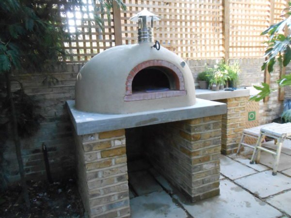 a stylish oven, four grand-mere, wood fired oven, pizza oven